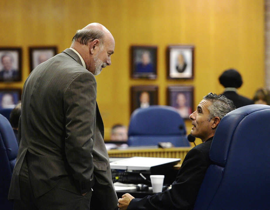 Superintendent Vern Butler, left, speaks with manager Lenny Caballero before Monday evening's meeting. The Beaumont Independent School District's board of managers met Monday night to discuss the employment of Jessie Haynes. The board voted unanimously to terminate Haynes.