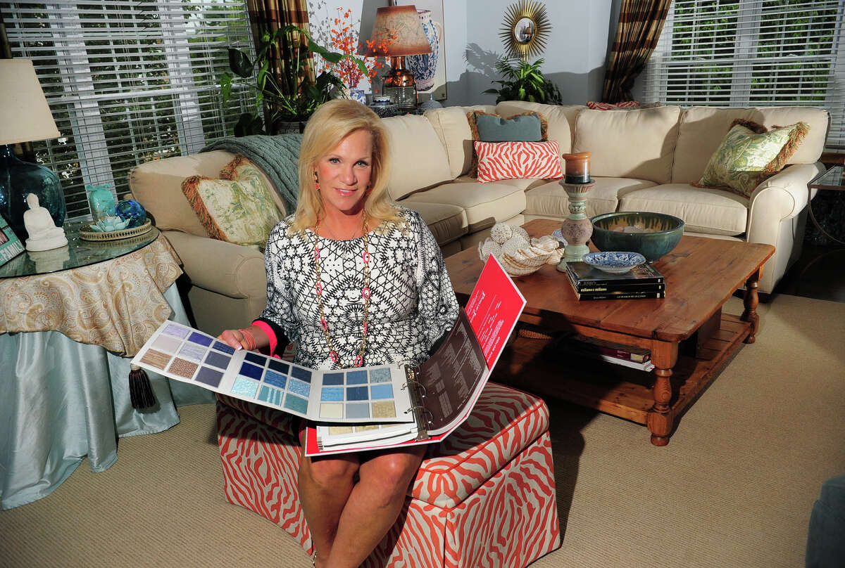 Interior designer Kelly Manthey-Sohigian poses at her home in Fairfield, Conn. on Tuesday September 9, 2014. She runs an interior design business servind Fairfield and Westchester Counties called kellydesigns.