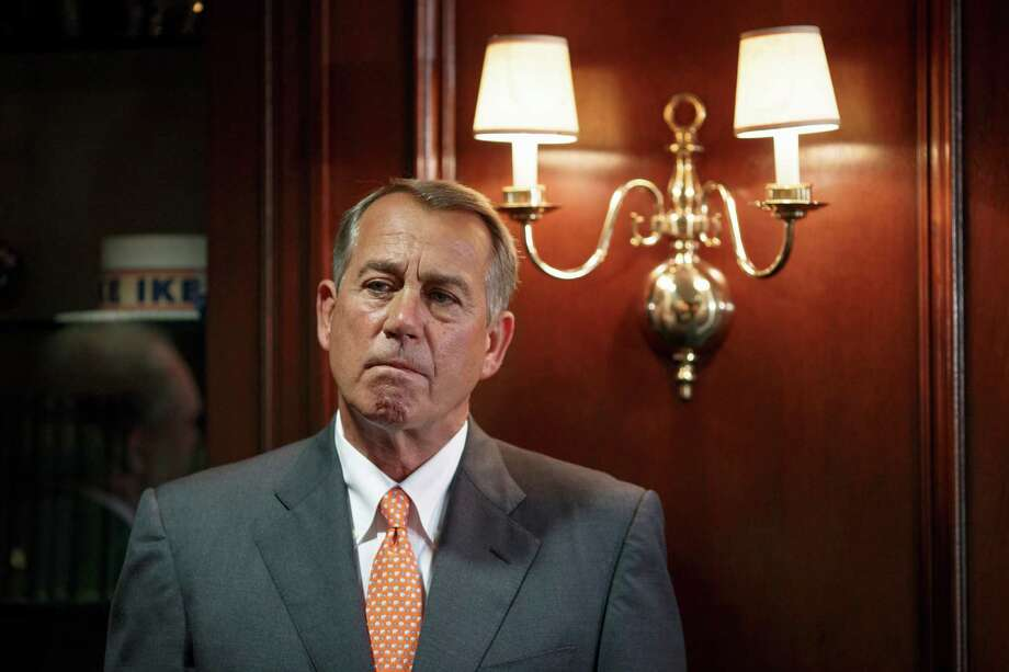 House Speaker John Boehner of Ohio waits to speak on Capitol Hill in Washington, Tuesday, Sept. 9, 2014, following a Republican strategy session after returning from a five-week recess. Boehner said Islamic State militants are a serious threat that must be dealt with in Iraq, Syria or wherever they exist and insisted that no decision would be made on a congressional vote until President Barack Obama lays out his strategy to defeat the militants. Boehner and other congressional leaders are heading to the White House this afternoon for a meeting with Obama.  (AP Photo/J. Scott Applewhite) Photo: J. Scott Applewhite, STF / AP