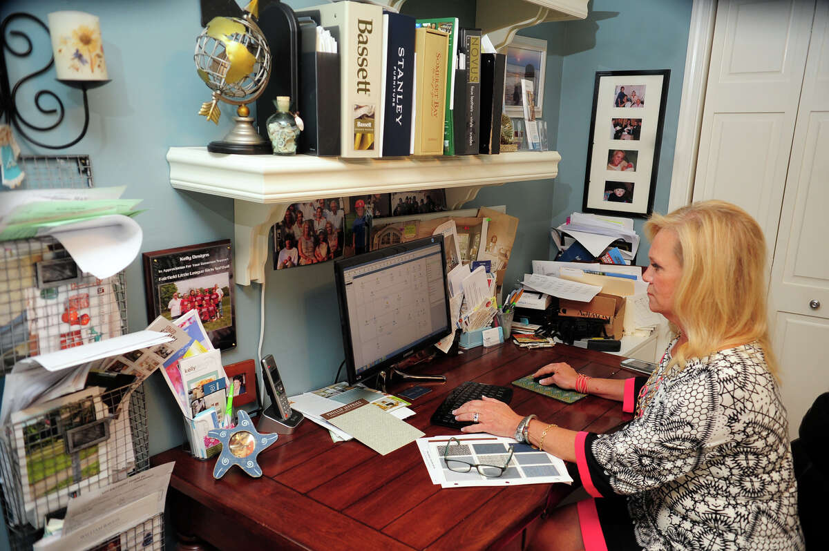 Interior designer Kelly Manthey-Sohigian works in her office at her home in Fairfield, Conn. on Tuesday September 9, 2014. She runs an interior design business serving Fairfield and Westchester Counties called kellydesigns.