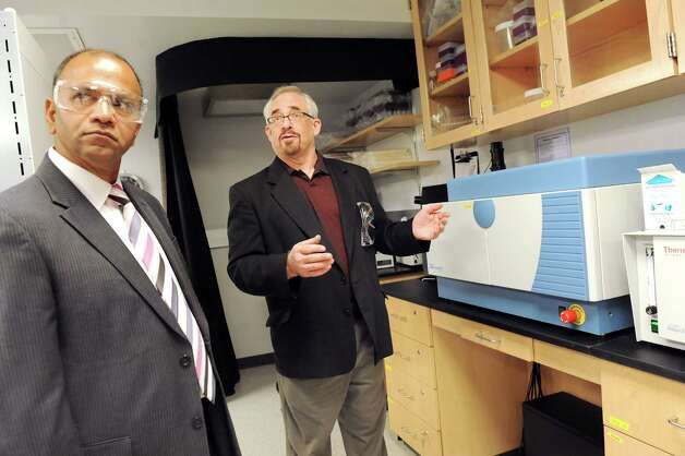 Director Deepak Vashishth, left, and associate director Glenn Monastersky of the Center for Biotechnology and Interdisciplinary Studies in the stem cell research laboratory on  Tuesday, Sept. 9, 2014, at Rensselaer Polytechnic Institute in Troy, N.Y. (Cindy Schultz / Times Union) Photo: Cindy Schultz / 00028426A