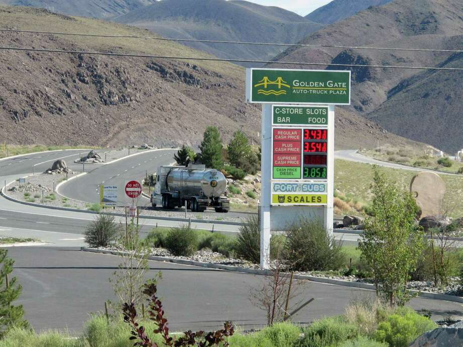 """A tanker passes the Golden Gate Auto Truck Plaza at the Tahoe Reno Industrial Center bound for U.S. Interstate 80, Thursday, Sept. 4, 2014, 15 miles east of Sparks, Nev., near the access road to the site where Tesla Motors Inc. plans to build a 6,500 worker """"gigafactory"""" to mass produce cheaper lithium batteries for its next line of more-affordable electric cars. (AP Photo/Scott Sonner) Photo: Scott Sonner, STF / ap"""