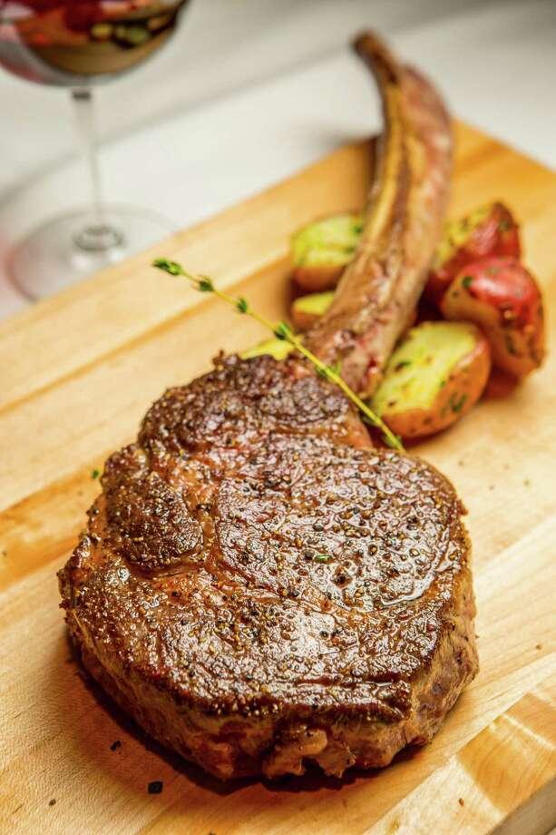 Bone-in American wagyu ribeye steak at Killen's Steakhouse in Pearland. ( Nick de la Torre ) Photo: Nick De La Torre, For The Chronicle / © de la Torre Photos LLC
