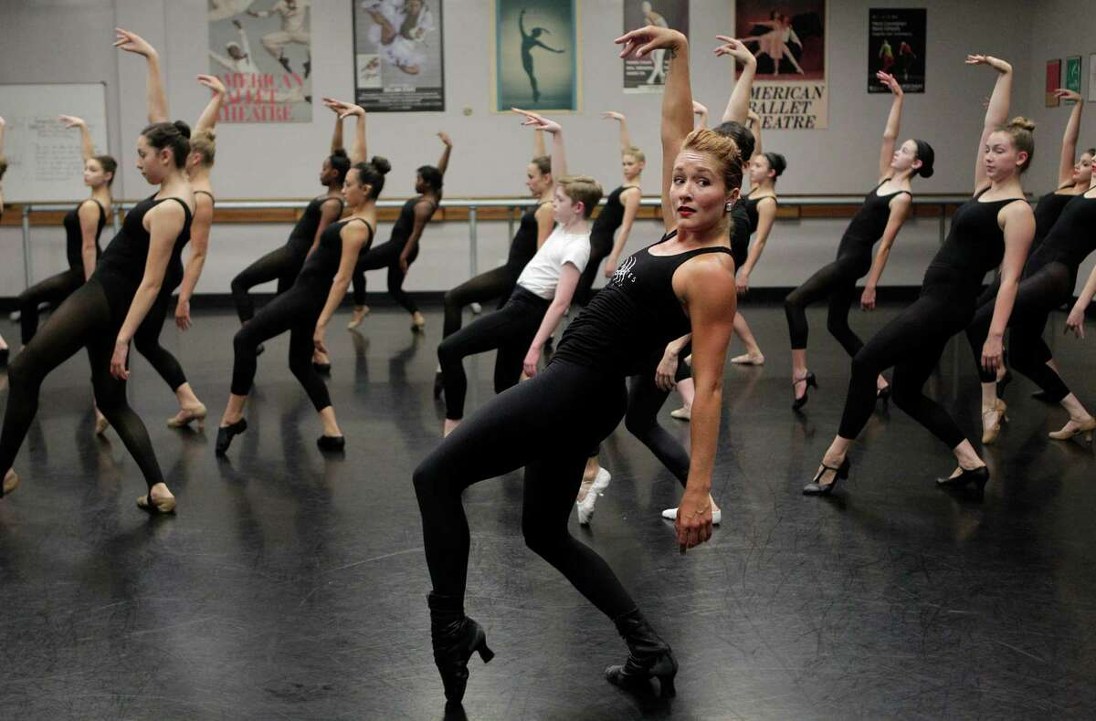 Students learn from The Radio City Rockettes, Jessica Osborne, as she teaches one of two master classes at The High School for the Performing and Visual Arts (HSPVA) on Tuesday, Sept. 9, 2014, in Houston.