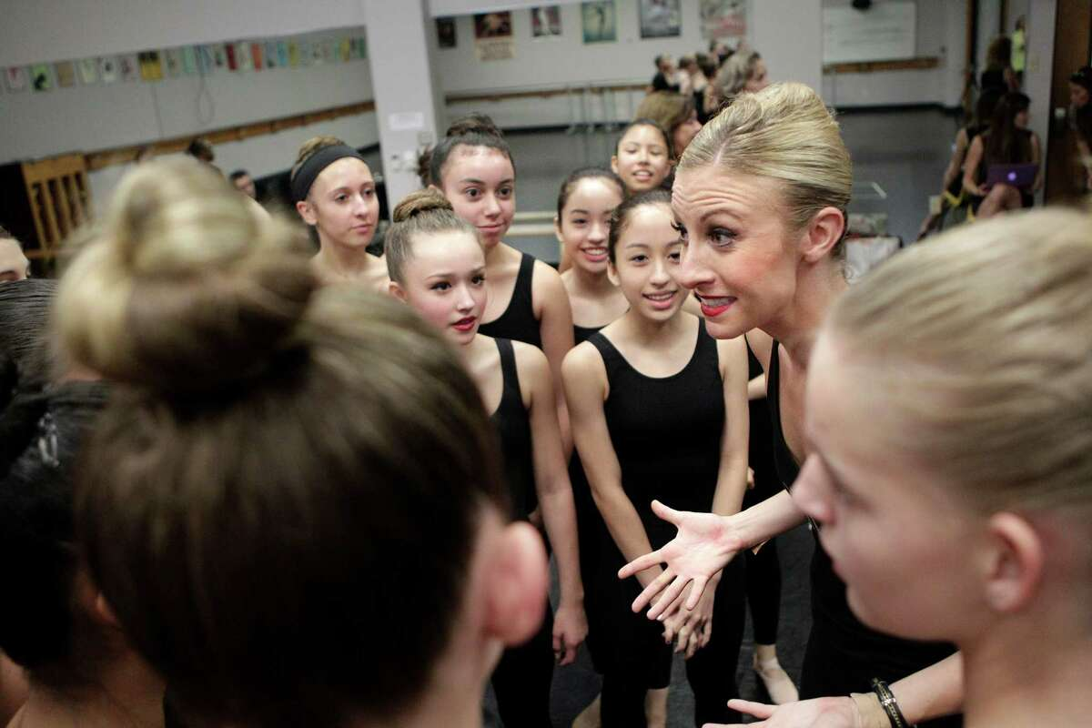 The Radio City Rockettes, Sarah Grooms, huddles her class right before students perform a learned routine while teaching one of two master classes at The High School for the Performing and Visual Arts (HSPVA) on Tuesday, Sept. 9, 2014, in Houston.