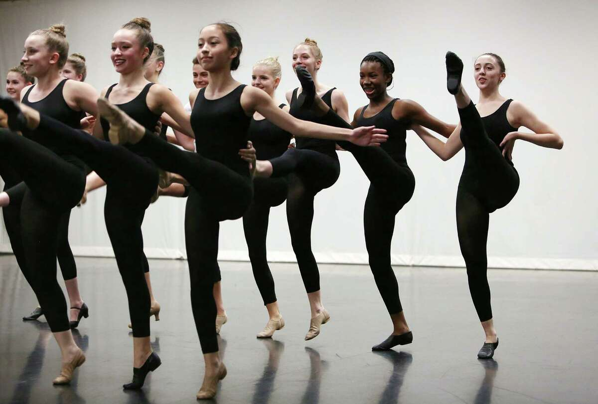 The High School for the Performing and Visual Arts Dance Majors perform a short routine they learned from The Radio City Rockettes, Sarah Grooms and Jessica Osborne, during a master class at The High School for the Performing and Visual Arts (HSPVA) on Tuesday, Sept. 9, 2014, in Houston.