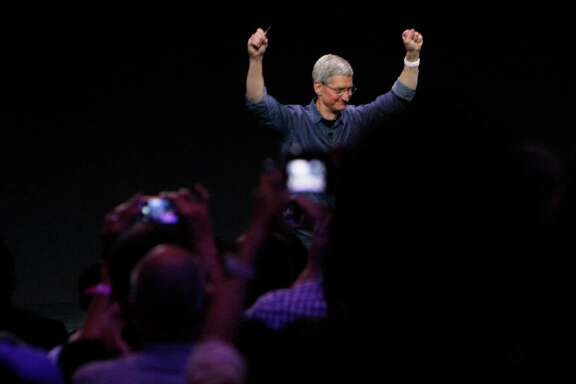 Tim Cook, Apple CEO, raises his arms after announcing the Apple Watch during the Apple announcement at  the Flint Center for the Performing Arts on Tuesday, September 9,  2014 in Cupertino, Calif.