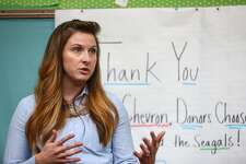 "First grade teacher Julie Solarek thanks donors as Seahawks wide receiver Jermaine Kearse, members of the Seagals, and representatives from Chevron deliver school supplies to her first grade classroom at Olympic Hills Elementary School in northeast Seattle. Chevron and DonorsChoose.org donated the supplies. Through Chevron's ""Fuel Your School"" campaign it is expected that $600,000 will be awarded to public schools in King County. Photographed on Tuesday, September 9, 2014. (Joshua Trujillo, seattlepi.com)"