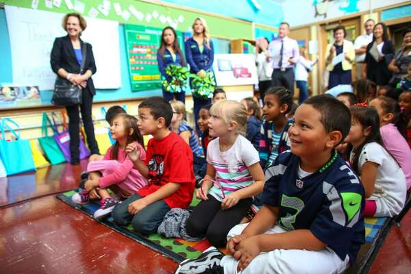 "Students gather as Seahawks wide receiver Jermaine Kearse, members of the Seagals, and representatives from Chevron deliver school supplies to a first grade classroom at Olympic Hills Elementary School in northeast Seattle. Chevron and DonorsChoose.org donated the supplies. Through Chevron's ""Fuel Your School"" campaign it is expected that $600,000 will be awarded to public schools in King County. Photographed on Tuesday, September 9, 2014. (Joshua Trujillo, seattlepi.com)"
