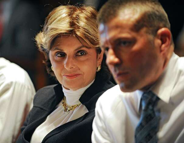Plaintiff attorney Gloria Allred looks at sexual assault victim Bobby Davis during a defamation suit case against Syracuse University and basketball coach James Boeheim at the State Court of Appeals on Tuesday, Sept. 9, 2014 in Albany, N.Y. (Lori Van Buren / Times Union) Photo: Lori Van Buren / 00028527A