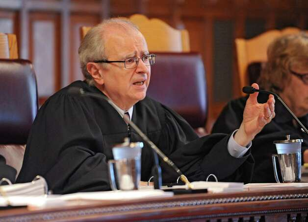 Chief Judge of the New York Court of Appeals Jonathan Lippman speaks to an attorney during a defamation suit case against Syracuse University and basketball coach James Boeheim at the State Court of Appeals on Tuesday, Sept. 9, 2014 in Albany, N.Y. (Lori Van Buren / Times Union) Photo: Lori Van Buren / 00028527A
