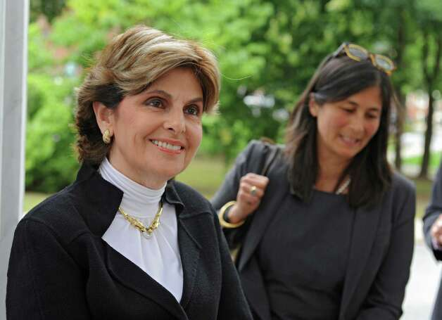 Plaintiff attorneys Gloria Allred, left, and Mariann Meier Wang talk to reporters after a defamation suit case was presented to the judges against Syracuse University and basketball coach James Boeheim at the State Court of Appeals on Tuesday, Sept. 9, 2014 in Albany, N.Y. (Lori Van Buren / Times Union) Photo: Lori Van Buren / 00028527A