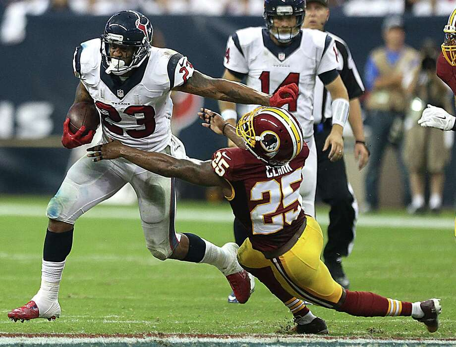 In a display of Bill O'Brien's offensive philosophy, Arian Foster received a steady workload Sunday, carrying 27 times for 103 yards. Photo: Brett Coomer, Staff / © 2014  Houston Chronicle