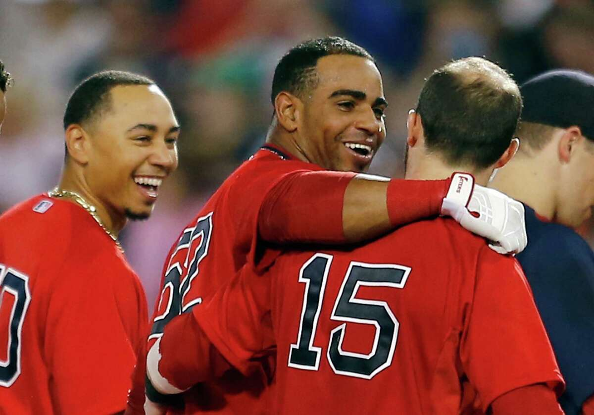 BOSTON, MA - SEPTEMBER 5: Yoenis Cespedes #52 of the Boston Red Sox celebrates with Dustin Pedroia #15 of the Boston Red Sox after knocking in the winning run in the 10th inning with a double at Fenway Park on September 5, 2014 in Boston, Massachusetts. (Photo by Jim Rogash/Getty Images)