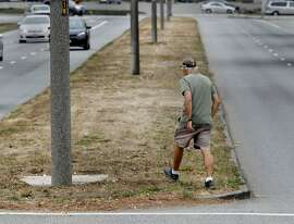 "Longtime resident Larry Katzeff crosses to the median of Sunset Boulevard which he says should be better landscaped Tuesday September 9, 2014. The walkways and median along Sunset Boulevard in San Francisco, Calif. are brown like many lawns across the Bay Area, but longtime residents complain that there has been little effort at landscaping. ""This is pure neglect,"" says resident Larry Katzeff."