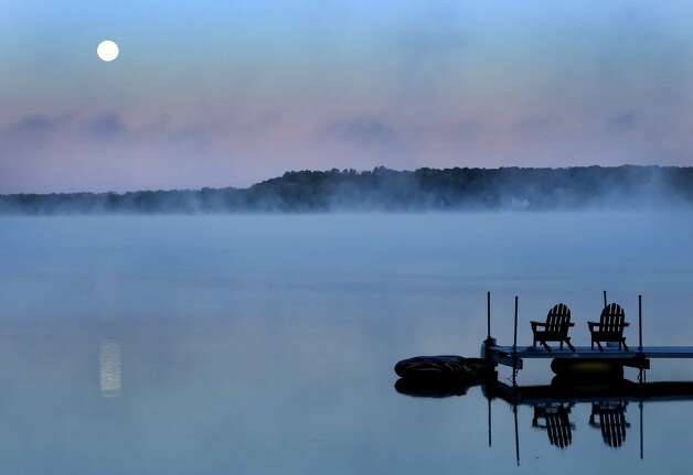 The harvest moon hangs above Saratoga Lake early Tuesday morning Sept. 9, 2014 in Saratoga Springs, N.Y.  (Skip Dickstein/Times Union) Photo: SKIP DICKSTEIN