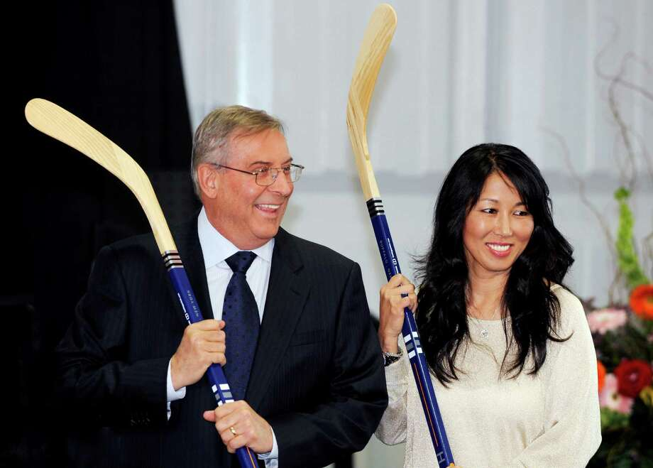 FILE - In this April 13, 2013, file photo, Buffalo Sabres' owner Terry Pegula and his wife, Kim Pegula, pose for cameras during groundbreaking ceremonies at First Niagara Center in Buffalo, N.Y. The next step in the sale of the Buffalo Bills happens on Monday, Sept. 8, 2014, when prospective ownership groups face a deadline to submit their formal bids. Buffalo Sabres owners Terry and Kim Pegula are among at least three candidates still in the running to buy the franchise, which is for sale after Hall of Fame owner Ralph Wilson died in March.(AP Photo/Gary Wiepert, File) Photo: Gary Wiepert, FRE / FR170498 AP
