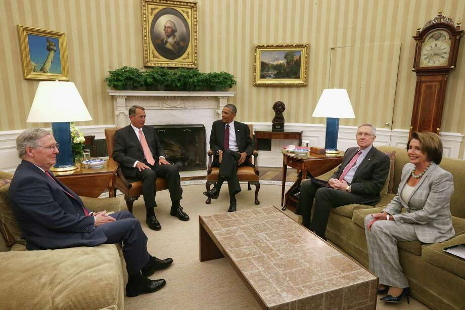 President Barack Obama meets with, from left,  Senate Majority Leader Mitch McConnell, Speaker John Boehner, Senate Majority Leader Harry Reid and House Minority Leader Nancy Pelosi in the Oval Office to discuss the U.S. response to the Islamic State. Photo: Chip Somodevilla, Staff / 2014 Getty Images