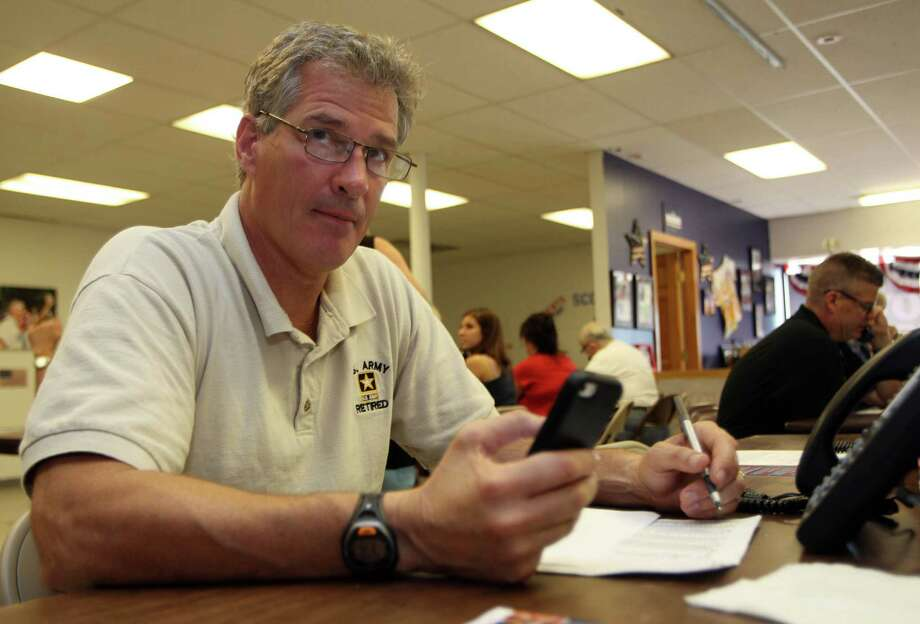 Scott Brown, a former U.S. Senator from Massachusetts, makes phone calls to voters from his headquarters Tuesday Sept. 9, 2014 in Manchester, N.H. Brown moved to New Hampshire and is seeking the  Republican party nomination for U.S. Senate hoping to unseat Democrat Jeanne Shaheen. (AP Photo/Jim Cole) Photo: Jim Cole, STF / AP