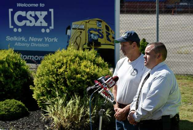 Paul Cox, NTSB investigator, left, and Detective Sgt. Adam Nornick of the Bethlehem PD give details Tuesday morning, Sept. 9, 2014, on the plane crash that took place at the Selkirk rail yard Monday evening in Selkirk, N.Y.  (Skip Dickstein/Times Union) Photo: SKIP DICKSTEIN / 00028524A