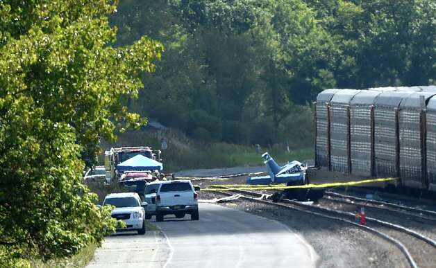 The remains of a Cessna 172 sits on active rails at the Selkirk Rail yard Tuesday afternoon Sept 9, 2014 after it crashed into the rail cars Monday evening in Selkirk, N.Y., killing the pilot and student pilot. (Skip Dickstein/Times Union) Photo: SKIP DICKSTEIN / 00028524A
