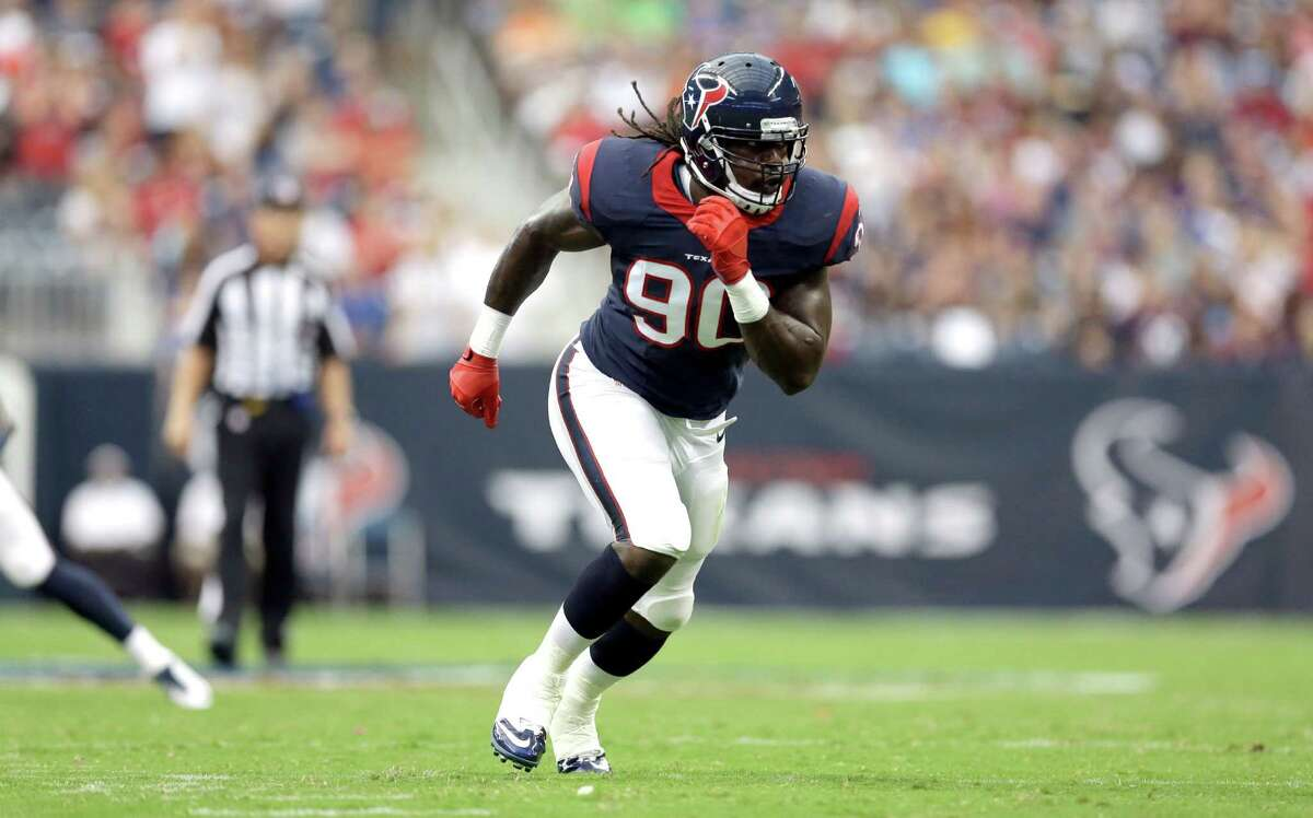 Houston Texans linebacker Jadeveon Clowney (90) lines up against the Atlanta Falcons during the first quarter of an NFL preseason football game Saturday, Aug. 16, 2014, in Houston. (AP Photo/Patric Schneider)