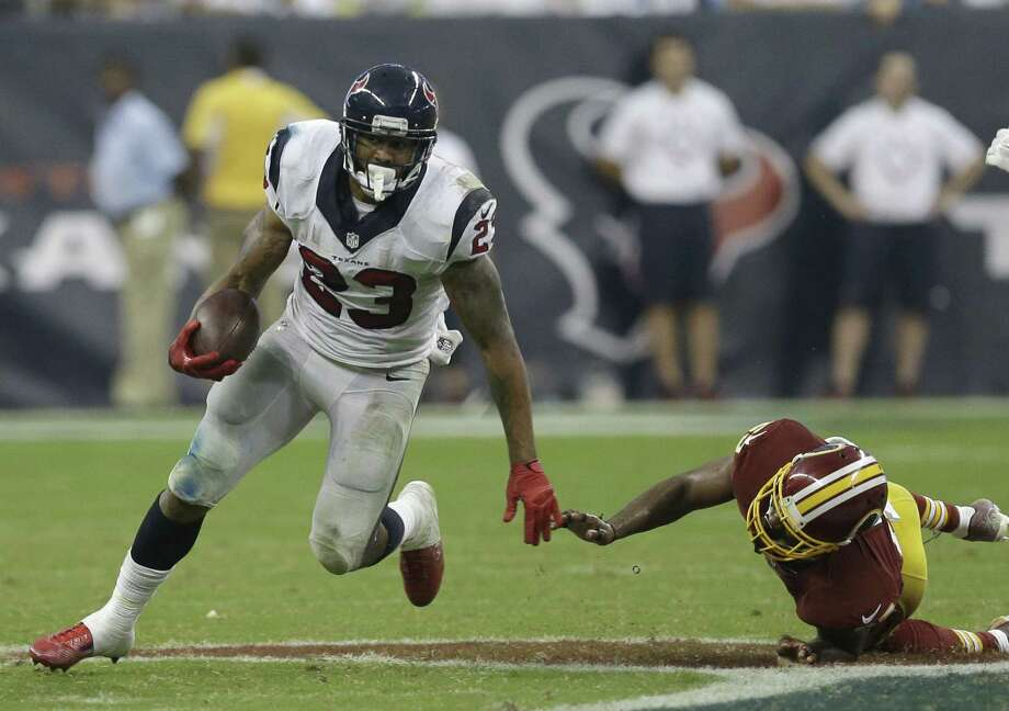 Running back Arian Foster, who was injured much of last year and missed 10 games, carried Houston offensively in a win over Washington. Photo: David J. Phillip / Associated Press / AP
