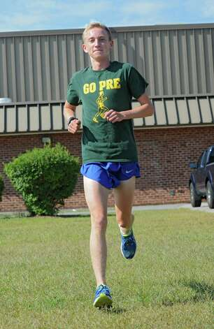Saratoga cross-country runner Aidan Tooker practices outside the high school on Thursday, Sept. 4, 2014 in Saratoga Springs, N.Y. (Lori Van Buren / Times Union) Photo: Lori Van Buren / 00028447A