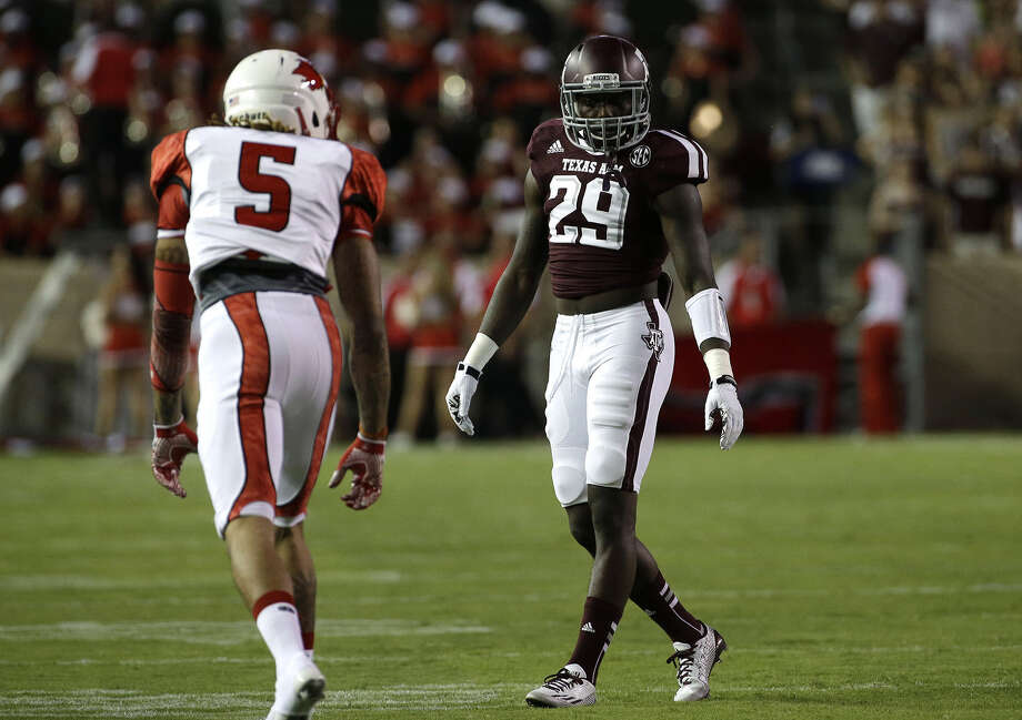 "Aggies senior Deshazor Everett (29) likes new secondary coach Terry Joseph's approach. ""He enforces communication, and that's what we need,"" Everett said. Photo: David J. Phillip / Associated Press / AP"