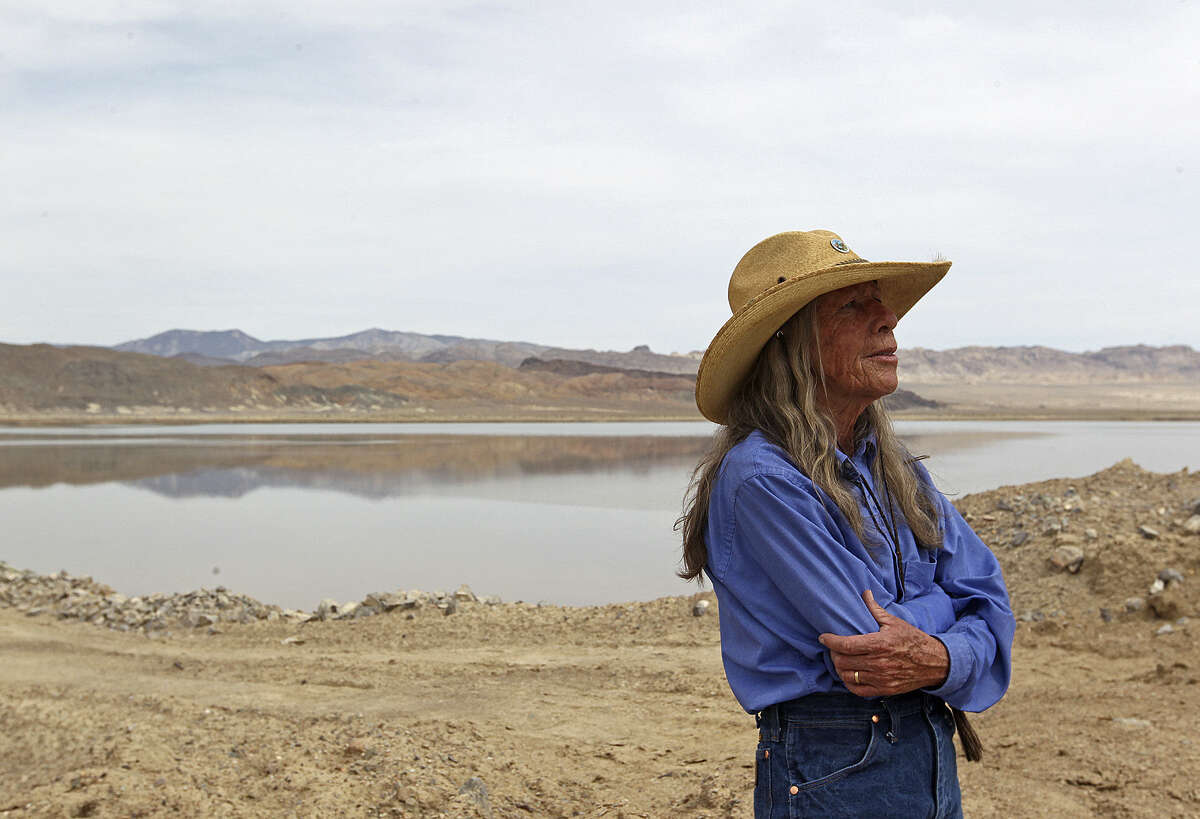 Esmeralda County Commissioner Nancy Boland stands by brine ponds in the Clayton Valley by Silver Peak, Nevada. The brine contains lithium that's concentrated when the water evaporates and is a necessity for Tesla's batteries.