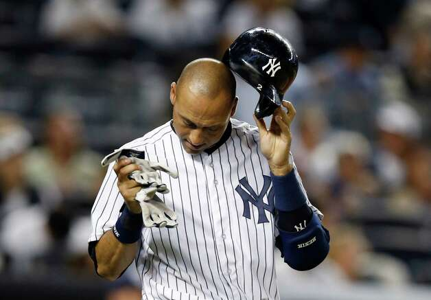 New York Yankees' Derek Jeter removes his batting helmet after lining out into an inning-ending double play in the fifth inning of a baseball game against the Tampa Bay Rays at Yankee Stadium in New York, Tuesday, Sept. 9, 2014. (AP Photo/Kathy Willens) ORG XMIT: NYY113 Photo: Kathy Willens / AP