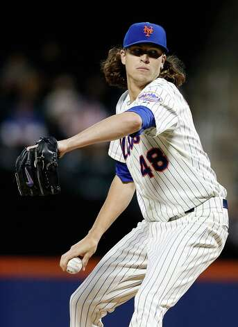 NEW YORK, NY - SEPTEMBER 09:  Jacob deGrom #48 of the New York Mets pitches in the first inning against the Colorado Rockies at Citi Field on September 9, 2014 in the Flushing neighborhood of the Queens borough of New York City.  (Photo by Mike Stobe/Getty Images) ORG XMIT: 477589649 Photo: Mike Stobe / 2014 Getty Images