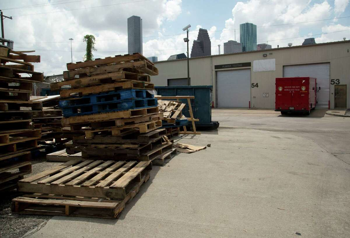 Wooden pallets clutter one side of the City of Houston Fire Department Logistical Center and Maintenance Depot at 1205 Dart Tuesday September 9, 2014.