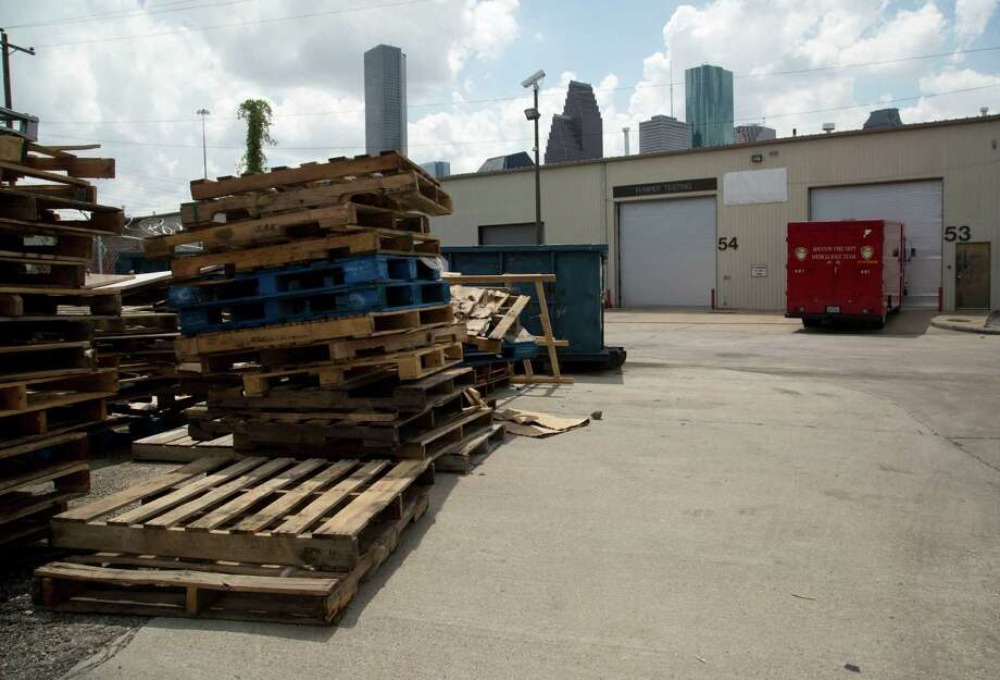 Wooden pallets clutter one side of the City of Houston Fire Department Logistical Center and Maintenance Depot at 1205 Dart Tuesday September 9, 2014.  Photo: Billy Smith II, Houston Chronicle / © 2014 Houston Chronicle