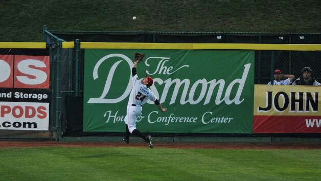 ValleyCats player Derek Fisher reaches out for a fly ball but misses the catch during the final game of the New York-Penn League Championship at Joe Bruno Stadium on Tuesday, Sept. 9, 2014, in Troy, N.Y.  (Paul Buckowski / Times Union) Photo: Paul Buckowski / 00028501A