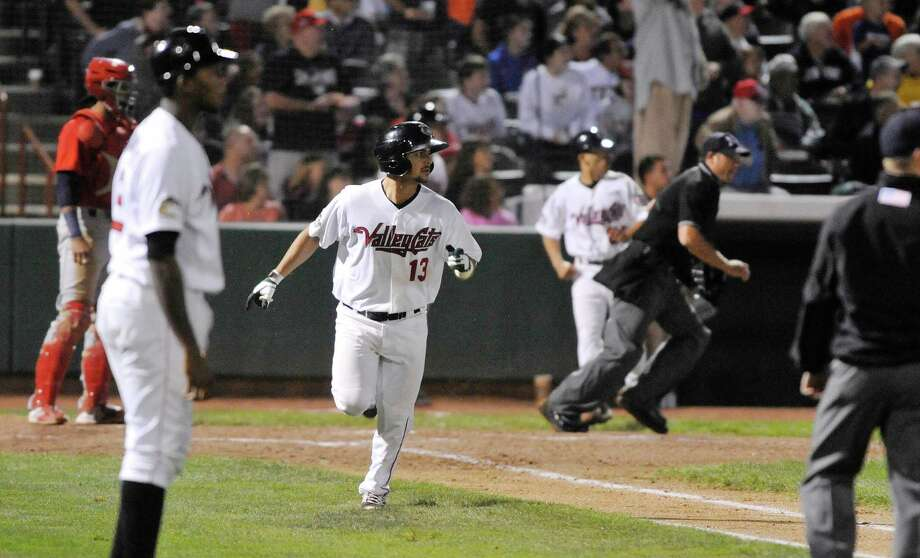 ValleyCats player Alex Hernandez watches his hit sail into the outfield during the final game of the New York-Penn League Championship at Joe Bruno Stadium on Tuesday, Sept. 9, 2014, in Troy, N.Y.  The hit was caught for a out.  (Paul Buckowski / Times Union) Photo: Paul Buckowski / 00028501A