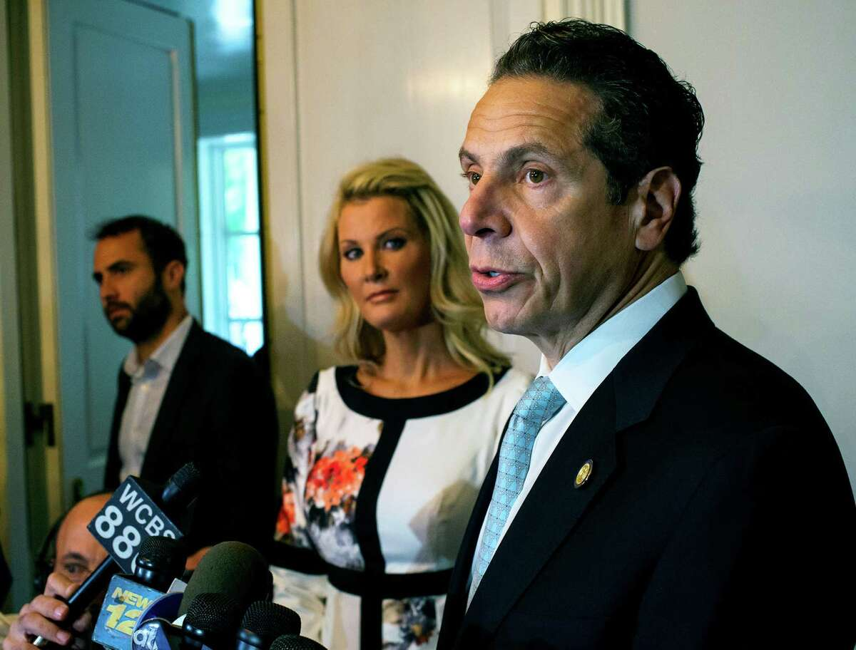 Governor Andrew Cuomo, standing with his partner Sandra Lee, center, address members of the media after casting a vote in the primary election Tuesday, Sept. 9, 2014 at the Presbyterian Church of Mount Kisco in Mount Kisco, New York. (AP Photo/Craig Ruttle) ORG XMIT: NYCR110
