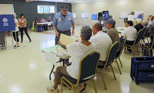 Barry Pollack, center, signs in to vote at the Mater Christi Parish Center polling place during Tuesday's primary, Sept. 9, 2014, in Albany, N.Y. (Lori Van Buren / Times Union) Photo: Lori Van Buren / 00028466A