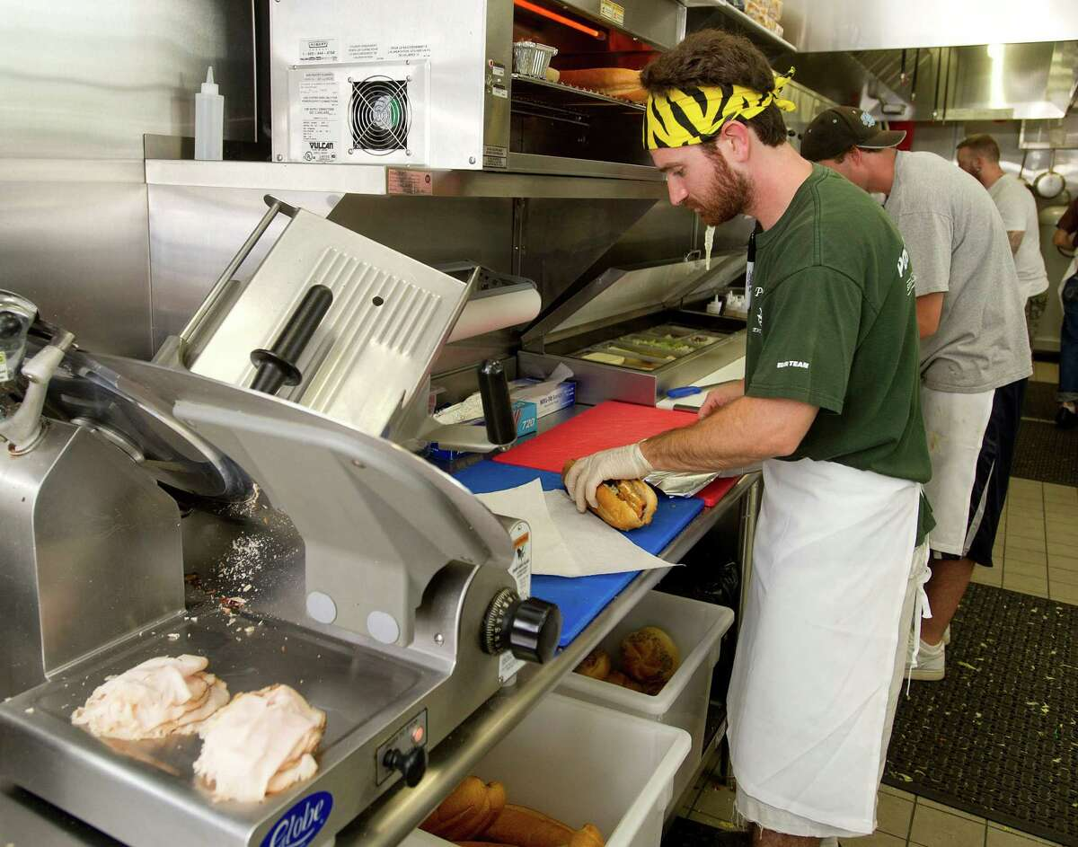 Co-Owner Jonathan Czarneski makes sandwiches during the lunch rush at Corbo's Deli in Harbor Point in Stamford, Conn., on Friday, September 5, 2014.