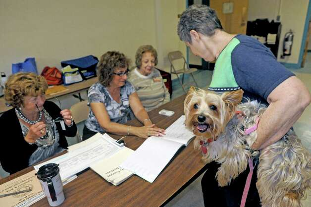 Barbara Harris of Schenectady brings her Yorkshire terrier, Simmi, along while she votes at Eastern Parkway United Methodist polling place on Tuesday Sept. 9, 2014 in Schenectady, N.Y. (Michael P. Farrell/Times Union) Photo: Michael P. Farrell / 00028516A