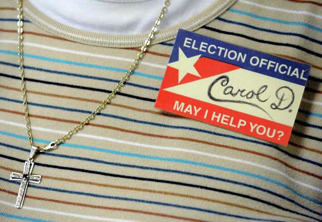 Election official Carol Di Cerbo wears a name card made by her friend Ron Wells as she attends to the polls at Eastern Parkway United Methodist on Tuesday Sept. 9, 2014 in Schenectady, N.Y. (Michael P. Farrell/Times Union) Photo: Michael P. Farrell / 00028516A