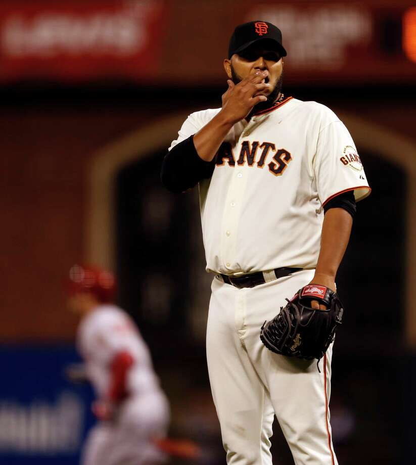 San Francisco Giants' starting pitcher Yusmeiro Petit reacts to giving up 4th inning home run to Arizona Diamondbacks' Ender Inciarte during MLB game at AT&T Park in San Francisco, Calif. on Tuesday, September 9, 2014. Photo: Scott Strazzante, Staff Photographer / The Chronicle / ONLINE_YES