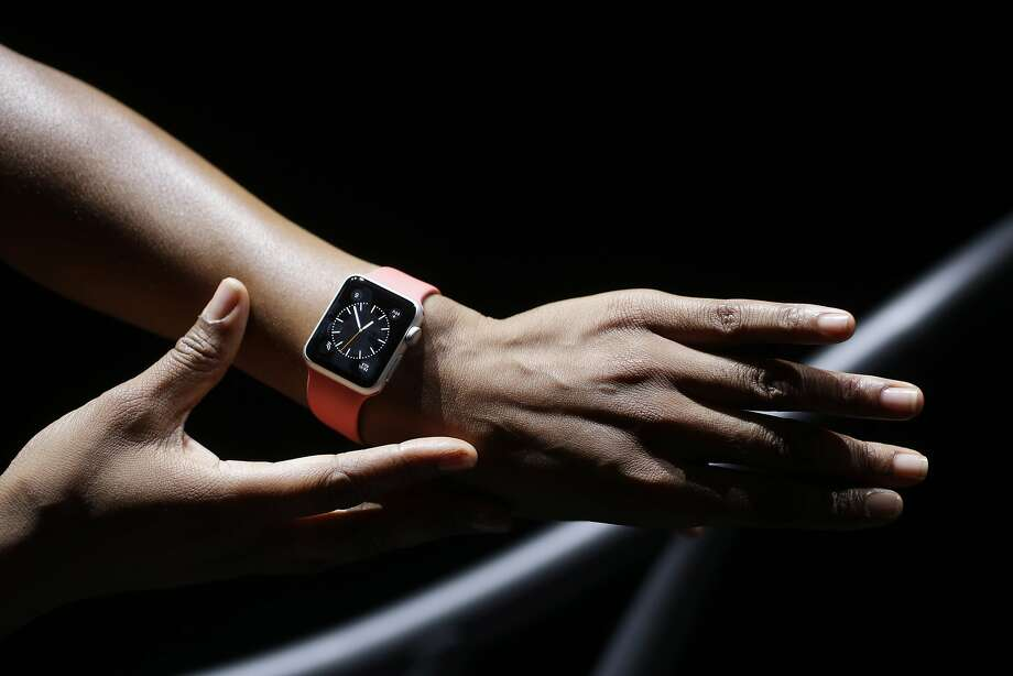 The new Apple Watch is shown by a model on a treadmill during a new product release on Tuesday, Sept. 9, 2014, in Cupertino, Calif. (AP Photo/Marcio Jose Sanchez) Photo: Marcio Jose Sanchez, Associated Press