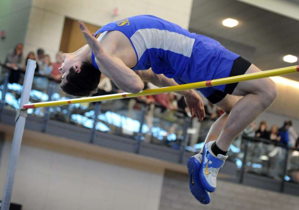 Seymour's Jacob Drozd clears the high jump bar Saturday Feb. 20, 2010 at the CIAC State Championship Indoor Track and Field meet at the New Haven Athletic Center.