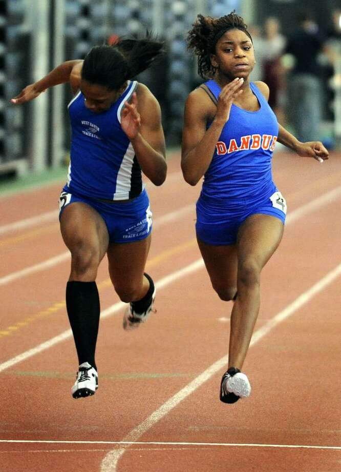 Danbury's Teyanna Green edges out West Haven's Ada Udaya for first place in the 55 Meter Dash finals Saturday Feb. 20, 2010 at the CIAC State Championship Indoor Track and Field meet at the New Haven Athletic Center. Photo: Autumn Driscoll / Connecticut Post