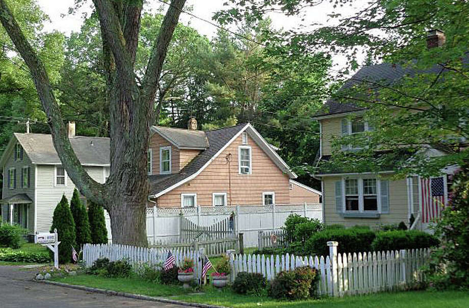 Residents of the Maplewood Avenue neighborhood are split over a proposal to designate the area as a local historic district. Photo: File Photo / Westport News