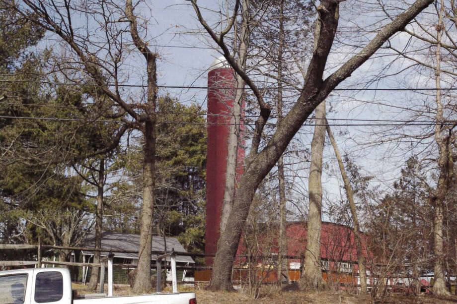 The proposed cell tower at Ox Ridge Hunt Club from the corner of Middlesex Avenue and Saddle Ridge Road. Photo: Contributed Photo, Contributed / Darien News Contributed