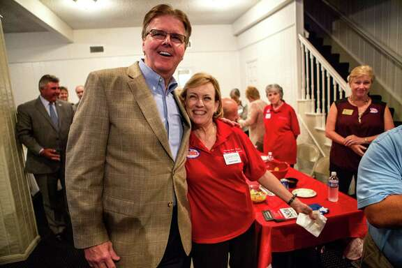 Senator Dan Patrick poses for a photo with supporter, Linda Flower, right, during a Tea Party Republican Women meeting at the Greenwood Forest Residents Club, Tuesday, Sept. 9, 2014, in Houston.