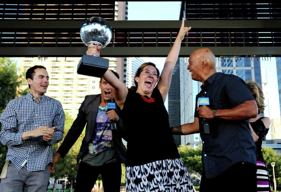 "Hosts Cameron Mathison, second from left, and J. R. Martinez, far right, both formerly on All My Children, with winner Laura Rosilez, of Richmond, and participant Erick Hootman, at Good Morning America's ""Shake It and Dance Mirror Ball Tour"" at Discovery Green Wednesday, Sept. 10, 2014, in Houston, Texas. The winner of the dance off, Laura Rosilez, won two tickets to the ""Dancing With The Stars"" season premiere in Los Angeles, California. Photo: Gary Coronado, Houston Chronicle / © 2014 Houston Chronicle"