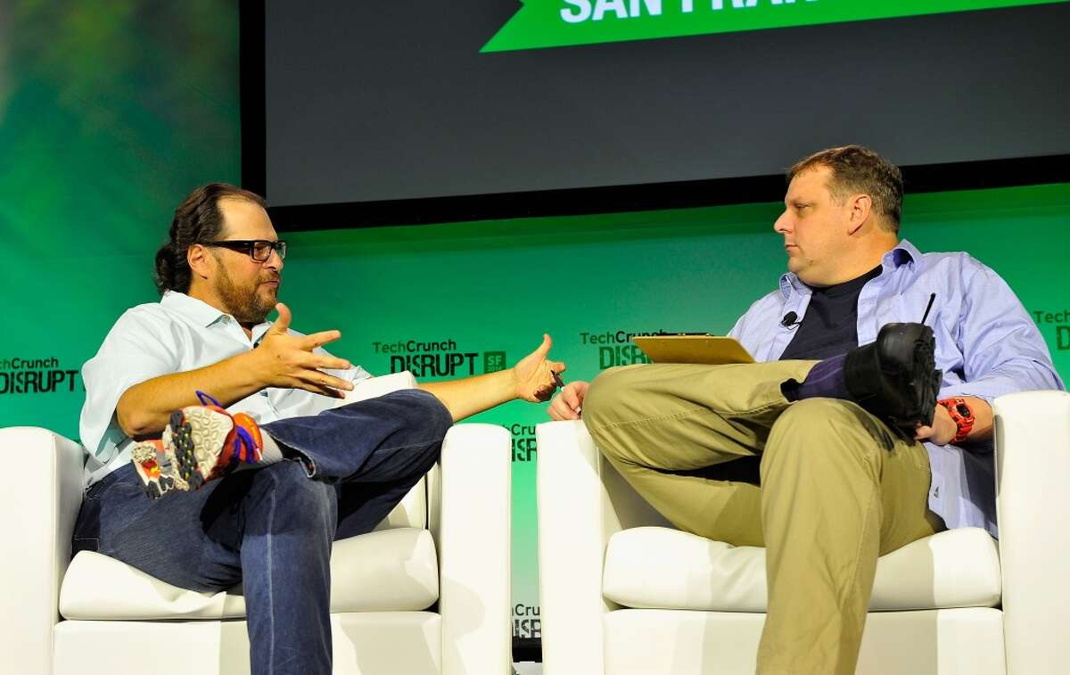 Salesforce Founder, Chairman and CEO Marc Benioff (left) and TechCrunch Founder Michael Arrington speak onstage at TechCrunch Disrupt at Pier 48 on September 9, 2014 in San Francisco.